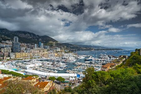 Monaco, Monte-Carlo, The famous place in Monaco - port Hercules, view from old town, a lot of boat, mega yachts and sail boats