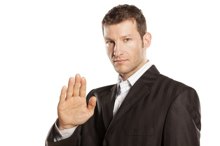 serious businessman with stop placed hand on white background Stock Photo - 17759468