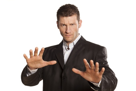 serious businessman with stop placed hands on white background Stock Photo - 17759434