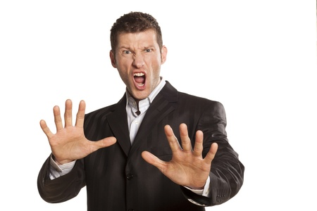 serious and angry businessman with stop placed hands on white background photo