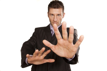 serious businessman with stop placed hands Stock Photo - 17785715