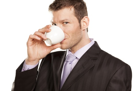 Smiling Businessman with Coffee Cup on White Background Stock Photo - 17785726