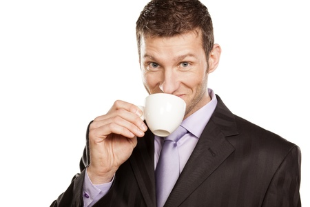 Smiling Businessman with Coffee Cup on White Background Stock Photo - 17785723