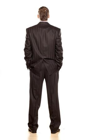 buena postura: Empresario de visi�n trasera en blanco