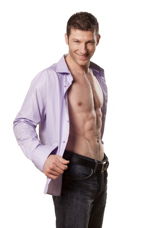 handsome athletic man with a smile and an open shirt on white background photo