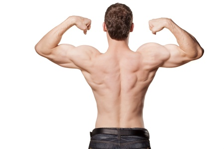 young sexy muscular macho man posing with naked torso from behind on white background photo