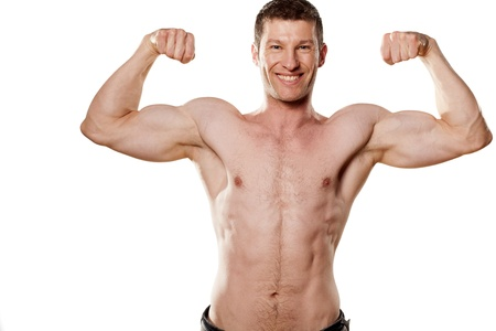 young sexy muscular macho man posing with naked torso on white background photo