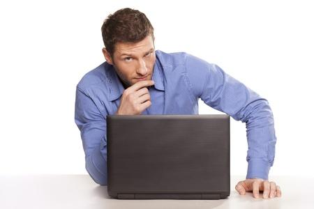 distrust: Attractive distrust businessman With Laptop, On White Background