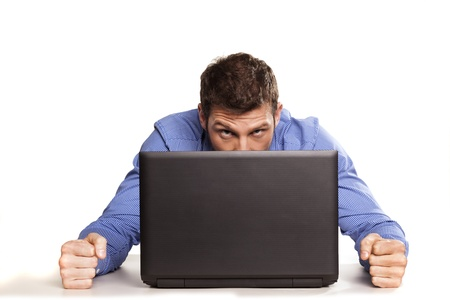Man frustrated with his laptop computer on white backrgound Standard-Bild