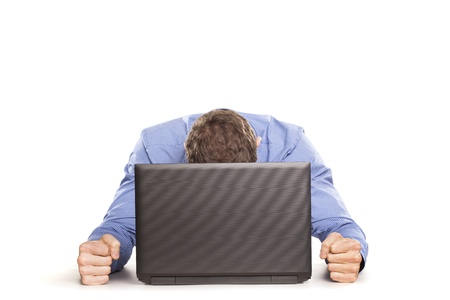 Man frustrated with his laptop computer on white backrgound Stock Photo