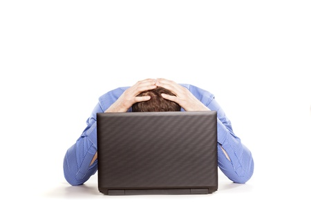 Man frustrated with his laptop computer on white backrgound photo