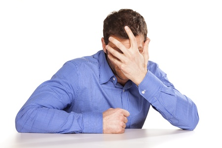 embarrassing man covers his face by hand