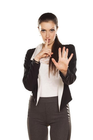 shushing: Young Brunette Gesturing for Quiet or Shushing, With Stop Hand