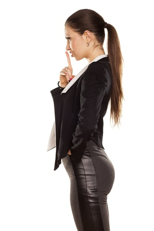 Young Brunette Gesturing for Quiet or Shushing