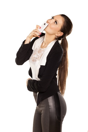 pretty brunette phone sends a love note on white background Stock Photo - 18064154