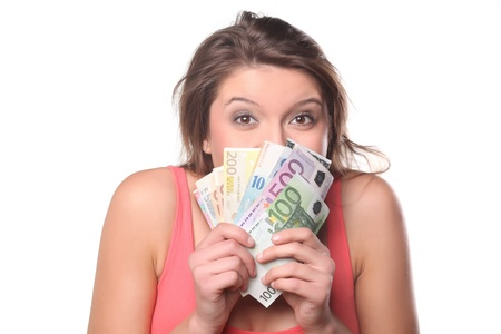 girl with money with a happy face on a white background Stock Photo - 18064042