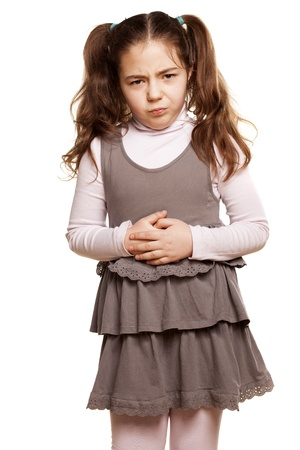 sweet little girl has a stomach pain on white background