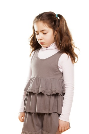 angry little girl in dress on white background photo