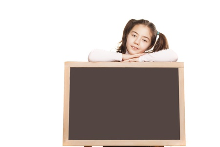 little girl leaning on a empty blackboard on white background photo