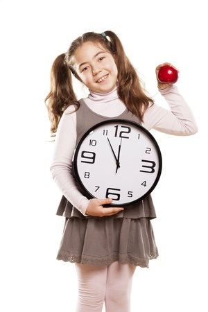 pre adolescent child: little girl shows that it is time to start eating healthy Stock Photo