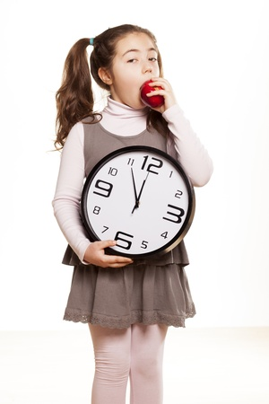 little girl shows that it is time to start eating healthy photo