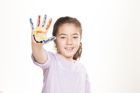 colors stained happy and smiling little girl showing five fingers on white background photo