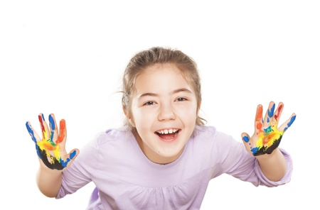 6 9 years: colors stained happy and smiling little girl showing ten fingers on white background