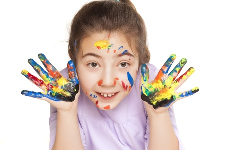 colors stained happy and smiling little girl showing ten fingers on white background photo