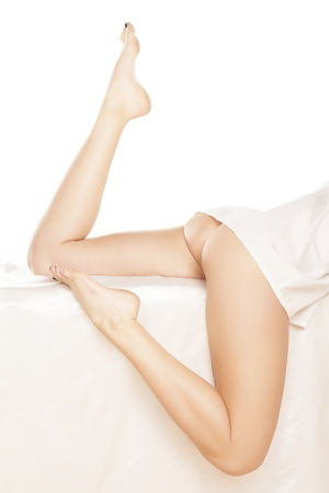 naked legs: Perfect girl s legs on white sheet  Stock Photo