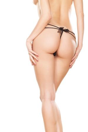 hintern: Perfect girl back in black thong Auf wei�em Hintergrund