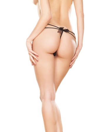 thong woman: Perfect girl back in black thong  On white background