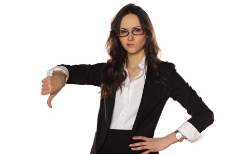 dissatisfied and angry business woman showing thumbs down photo