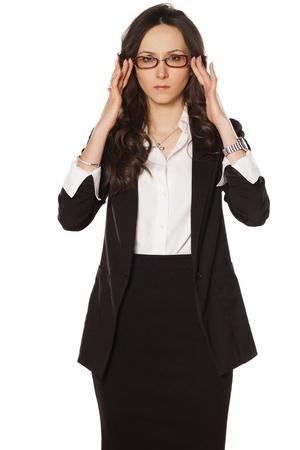 nervous business woman adjust her glasses photo