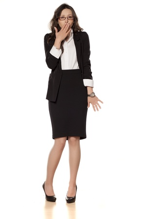 ashamed business woman posing on a white background photo