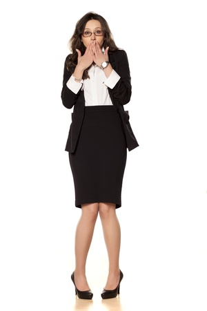 worried woman: ashamed business woman posing on a white background Stock Photo