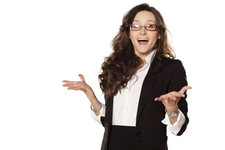 Smiling and surprised girl in glasses on white background Stock Photo - 18384513