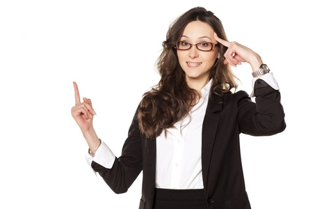 Smiling pretty business woman with a finger advertise the imaginary object Stock Photo - 18384521