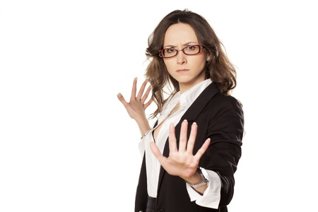 disclaim: nice business woman with stop placed hand Stock Photo