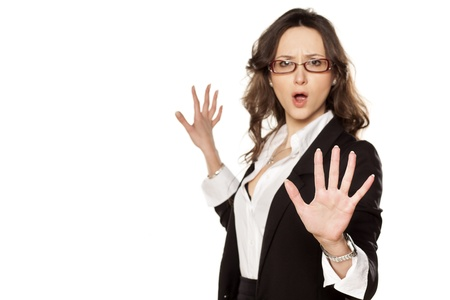nice screaming business woman with stop placed hand Stock Photo - 18384476