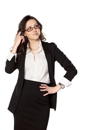 frowns: pretty business woman thinking and frowns on white background