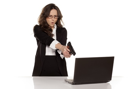 crazy woman: nervous and angry secretary destroys your laptop by using guns