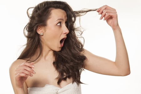 shocked girl because of her damaged hair Stock Photo