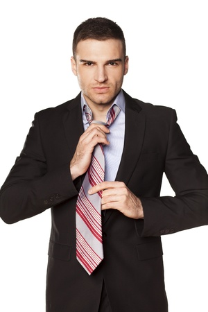 attractive businessman tied his tie before going to work