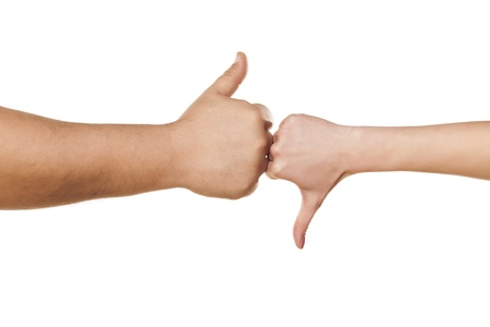 male and female hand showing thumbs like and dislike on white background photo