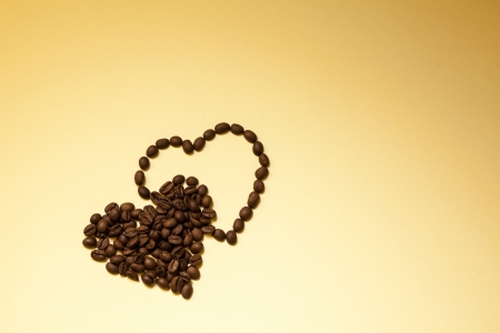 Hearts shape made from coffee beans photo