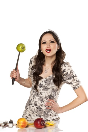 nice and angry chef standing with a knife in her hand