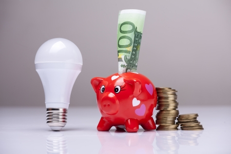 piggy bank and savings going from the use of LED light bulbs Stock Photo - 20534586