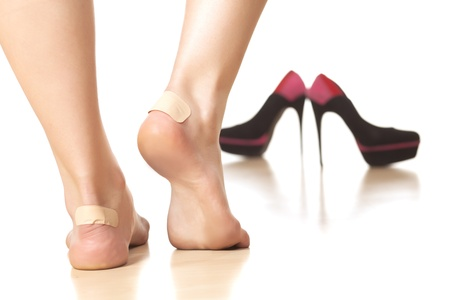 use of sticky plasters due to tight footwear Stock Photo - 21509990
