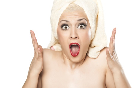 shocked blonde with a towel on her head  photo