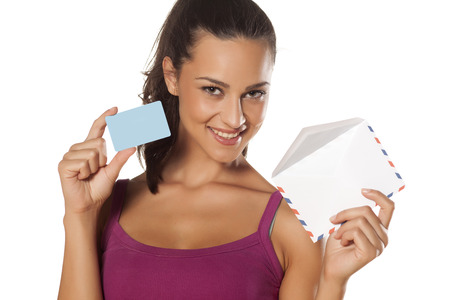 happy beautiful girl holding an envelope and showing her credit card photo